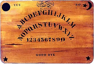 Ouija A flat wooden board with numbers and letters which is used to call and question the ghosts