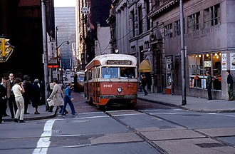 Pittsburgh Railways - PCC 1647 on a fantrip in Downtown Pittsburgh, signed for route 77/54