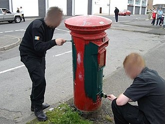 Sinn Féin Republican Youth - Members of Ógra Shinn Féin in Derry 2008 painting a Royal Mail postbox as part of the Green Post-Box Campaign.