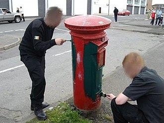 Ógra Shinn Féin - Members of Ógra Shinn Féin in Derry 2008 painting a Royal Mail postbox as part of the Green Post-Box Campaign.