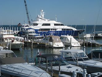 Grosse Pointe Yacht Club - The 131' UNITY yacht leaving the club's harbor in 2009. Built by Palmer Johnson Yachts in 2002, it is the largest vessel docked at the Grosse Pointe Yacht Club.