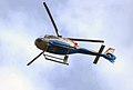 Passing helicopter (1464573580).jpg