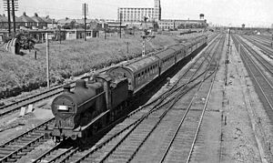 Peterborough railway station - Derby – Lowestoft holiday express approaching by the Midland's Melton Mowbray line in 1962