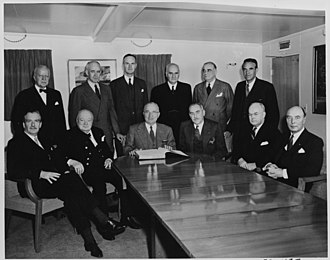 Oliver Franks, Baron Franks - Franks (standing, 3rd from left), as ambassador to the US, at the meeting of Truman and Churchill aboard USS Williamsburg (1952)