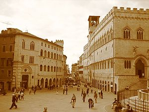 On the right, Palazzo Dei Priori (town hall), ...