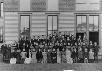 Plano Senior High School - All of the pupils of the Plano Public School standing outside the building in 1898