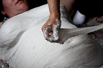 Belly cast - Applying plaster for a belly cast