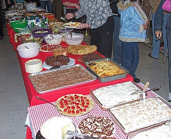 An assortment of food dishes at a church potluck.
