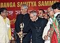 Pranab Mukherjee lighting the lamp to inaugurate the 86th Annual Convention of Nikhil Bharat Banga Sahitya Sammelan by lighting the lamp at Prayag Sangit Samiti, at Allahabad, in Uttar Pradesh. The Governor of Uttar Pradesh.jpg