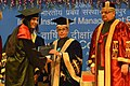 Pranab Mukherjee presenting the degree to a student at the 4th Annual Convocation of Indian Institute of Management (IIM) Raipur, at Raipur, Chhattisgarh. The Chief Minister of Chhattisgarh, Dr. Raman Singh is also seen.jpg