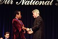 President Bill Clinton and Maya Angelou clasp hands following her being presented with the National Medal of Arts and Humanities.jpg