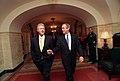 President Bill Clinton and President-Elect George W. Bush walk through the White House.jpg