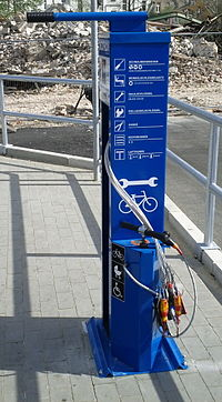 Public Bike Repair Station with tools and pump in front of the Decathlon retail store in Berlin-Schöneweide