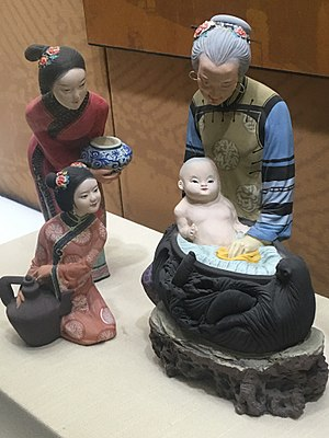 Qianlong Emperor - Figurine of the three year old Qianlong Emperor having a bath. Artefact in Yonghe Temple, Beijing.
