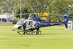 Queen's Baton arrival on NSW Police (VH-PHW) Eurocopter AS350B2 Ecureuil at Bolton Park ( MG 0224).jpg