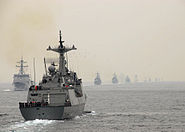 ROKS Kang Gamchan steams by a line of ROK Navy ships during the International Fleet Review