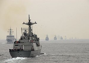ROKS Kang Gamchan steams by a line of ROK Navy ships during the International Fleet Review.jpg