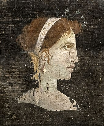 Most likely a posthumously painted portrait of Cleopatra with red hair and her distinct facial features, wearing a royal diadem and pearl-studded hairpins, from Roman Herculaneum, Italy, 1st century AD Retrato femenino (26771127162).jpg