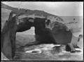 Rock arch forming a natural bridge at Tunnel Beach, ca 2 km west of St Clair, Dunedin. ATLIB 273680.png