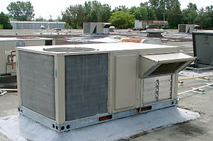 HVAC - Rooftop HVAC unit with view of fresh air intake vent.