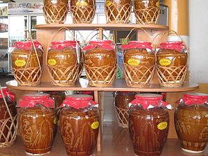 Rượu cần - Earthenware jars of rượu cần in a shop in Vũng Tàu city