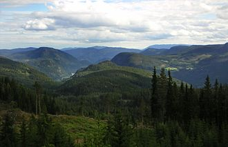Valdres - View over Begnadalen from Lærskogen, with the large woodland ranging all over to Randsfjorden on the left and Hedalsfjella in the right background.