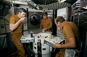 Space food - Skylab 2 crew eats food during ground training
