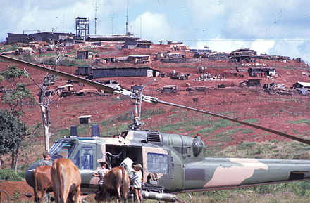 "A U.S. Air Force Bell UH-1P from the 20th Special Operations Squadron ""Green Hornets"" at a base in Laos, 1970. SOS Huey in Laos.jpg"