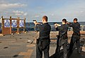 Sailors fire small arms on USS Underwood 121005-N-ZE938-004.jpg