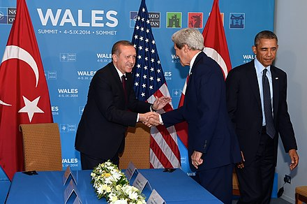 NATO Summit in Newport on 5 September 2014 Secretary Kerry Shakes Hands With Turkish President Erdogan Before Meeting With President Obama (15124679506).jpg