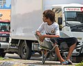 Semporna Sabah Bajau-teenager-waiting-for-bussiness-01.jpg