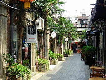 A shikumen lane in Tianzi Fang, with houses now converted into shops, studios, cafes and bars. Shanghai Tianzifang Shang Hai Tian Zi Fang  - panoramio.jpg