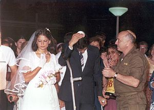 Simcha Holtzberg - Simcha Holtzberg (right) attends the wedding of a wounded soldier.