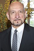 Photo of Ben Kingsley—a bald man with tan skin, of Indian ethnicity, with brown eyes, gray goatee and big nose, around 69 years of age—at the Sundance UK Film Festival in 2012.