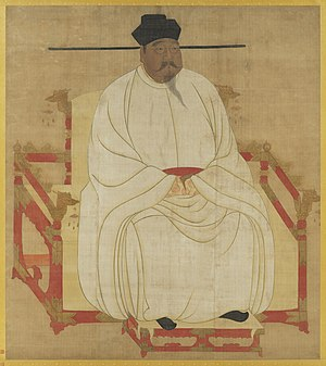 Painted image of a portly man sitting in a red throne-chair with dragon-head decorations, wearing white silk robes, black shoes, and a black hat, and sporting a black mustache and goatee