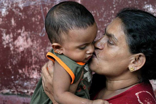 Love looks like something - grandson and grandmother in Sri Lanka. Photo by Steve Evans