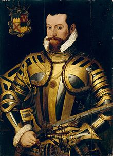 Portrait of the 10th Earl of Ormond in a black-and-gold armour holding a wheellock pistol, with his coat of arms at upper left. He has brown eyes and short black hair, with a reddish-brown mustache and beard.