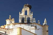 Storks' nest on the church (13349983395).jpg