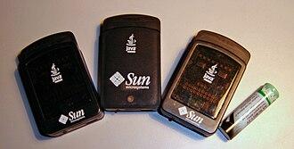 Sun SPOT - Sun SPOTs beside an AA battery