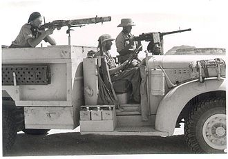 Long Range Desert Group - A 'T1' Patrol Chevrolet 1533X2 30 cwt: the small drum behind the front mudguard is the radiator condenser and the truck's sand channels are mounted on brackets on the rear bodywork. The weapons are the Lewis gun (left) and a .303 Browning Mk II (right)