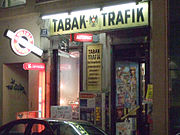 Tabak-Trafik in Vienna. Since January 1, 2007, all cigarette machines in Austria must attempt to verify a customer's age by requiring the insertion of a debit card or mobile phone verification.
