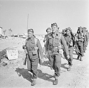 153rd Infantry Brigade (United Kingdom) - Men of the Gordon Highlanders of the Eighth Army cross the border into Tunisia, 1943.