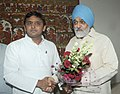 The Chief Minister of Uttar Pradesh, Shri Akhilesh Yadav meeting the Deputy Chairman, Planning Commission, Shri Montek Singh Ahluwalia for finalizing plan size for 2013-14 for the State, in New Delhi on July 18, 2013.jpg