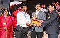 The Minister of State for Youth Affairs and Sports (IC) and Information & Broadcasting, Col. Rajyavardhan Singh Rathore presenting the awards, at the Closing Ceremony of the 22nd National Youth Festival (4).jpg