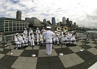 Navy Office of Community Outreach - The Navy Region Northwest Band performs during the last week of the month-long Seattle Sea Fair parade of ships.