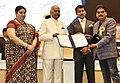 The President, Shri Ram Nath Kovind presenting the Nargis Dutt Award to Sumatial Popatla Shah for Best Feature Film on National Integration – DHAPPA, at the 65th National Film Awards Function, in New Delhi.JPG