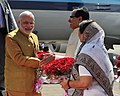 The Prime Minister, Shri Narendra Modi being received by the Chief Minister of Madhya Pradesh, Shri Shivraj Singh Chouhan, at Indore Airport, in Madhya Pradesh on March 05, 2015.jpg