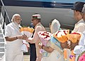 The Prime Minister, Shri Narendra Modi being received by the Chief Minister of Madhya Pradesh, Shri Shivraj Singh Chouhan, on his arrival at Indore Airport on May 14, 2016.jpg