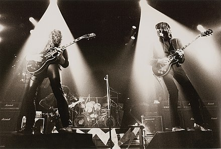 Thin Lizzy performing at the Manchester Apollo, showing their famous dual guitars on each side Thin Lizzy - Manchester Apollo - 1983 (2).jpg