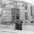 Three men at bridge - ads on wall for Lyons cafe and goods. (24638969284).jpg